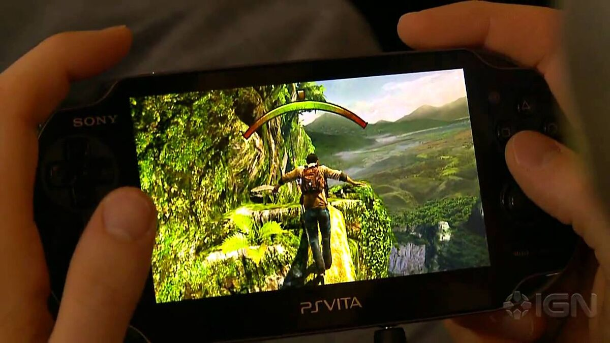 Hands playing Uncharted Golden Abyss on the PSVita