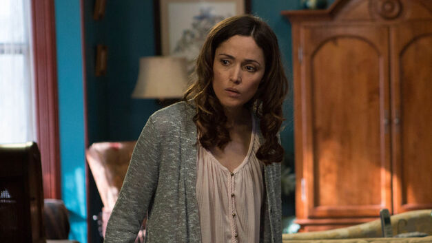 rose byrne as Renai Lambert checking out something strange in her house in Insidious