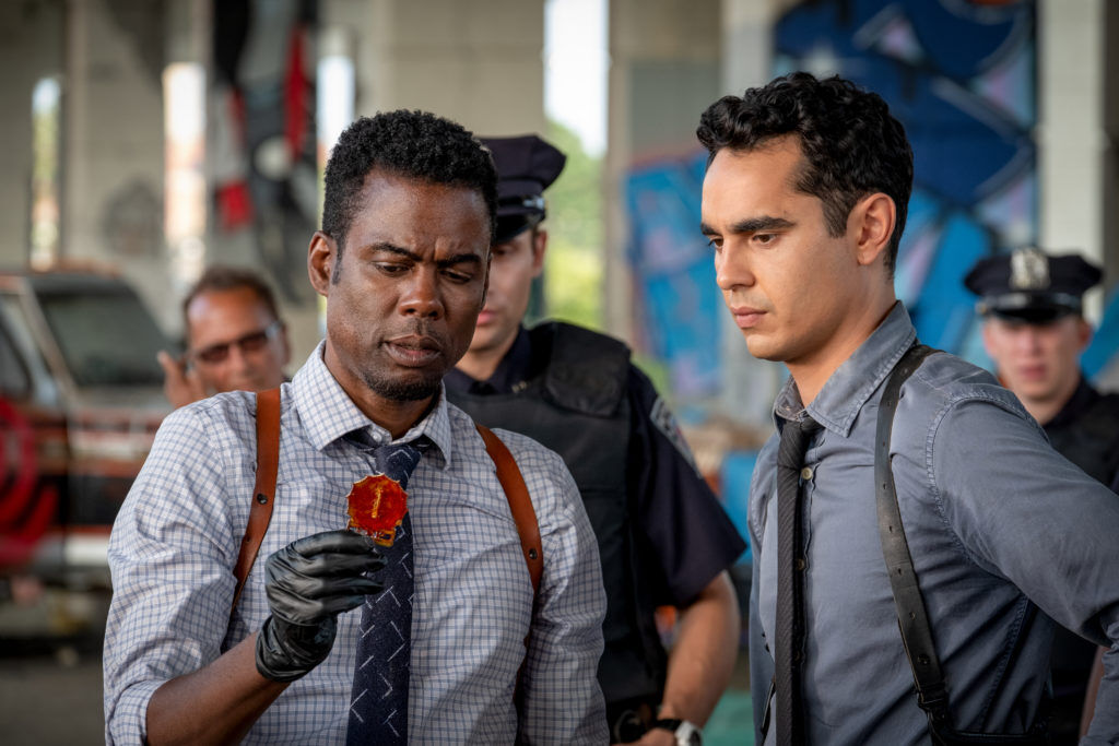 Max Minghella as William Schenk with Chris Rock as Det. Zeke Banks in Spiral.