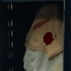 Underwear with a blood stain and 'HANNAH' painted on it in Zach's locker