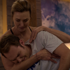Mrs. Walker comforting her crying son