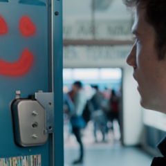 Clay seeing a spray painted smiley in his locker