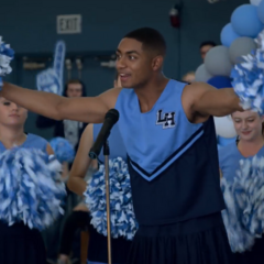 Marcus in a cheerleading uniform