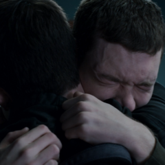 Tyler crying in Clay's arms