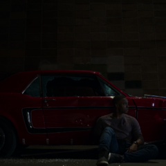 Caleb and Tony sitting in front of Tony's car