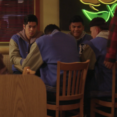 Zach and other jocks watching Marcus and Hannah