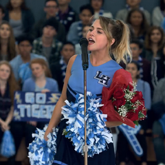 Chlöe announcing Marcus at a pep rally