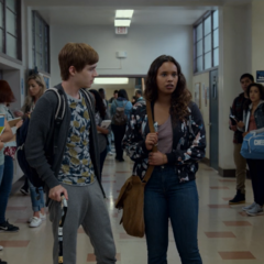 Alex and Jessica in the school hallway