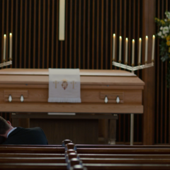 Jessica and Clay looking at Justin's casket
