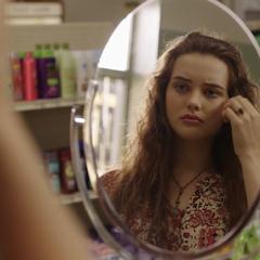 Hannah looking in a mirror