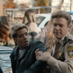 Officer Ted preventing Tony from getting arrested