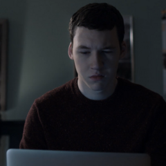 Tyler watching the pictures of Bryce's body