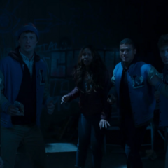 The students getting scared as someone's about to enter the cabin