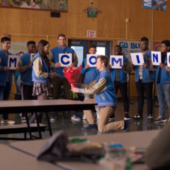 Jock asking a girl to Homecoming