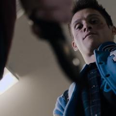 Alex threatening Monty with a knife