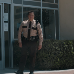 Sheriff Diaz standing outside the station
