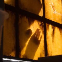 Someone climbing through the window