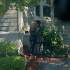 Mr. Baker kissing his girlfriend