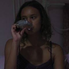 Jessica drinking in bed