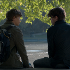 Alex and Winston talking on a bench