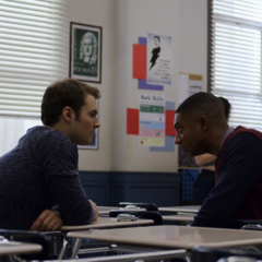 Bryce and Marcus talking in a classroom