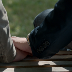 Winston placing his hand on Alex's