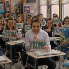 Charlie asking Alex to prom with help from other students