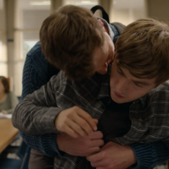 Charlie hugging Alex from behind