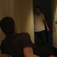 Bryce pushing Justin out of the room