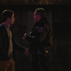Clay talking to a cop in a flashback