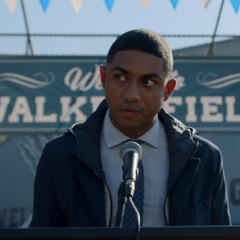 Marcus giving a speech at a baseball event