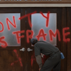 'Monty was framed' spray painted on the doors