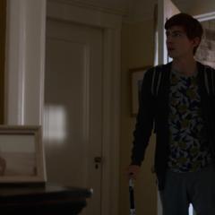Alex entering the Jensen's house