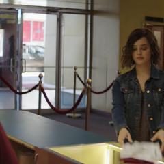 Hannah returning her uniform