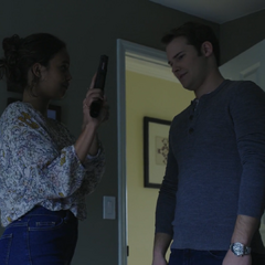 Jessica showing Bryce a gun