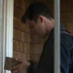 Clay finding a package in front of the house