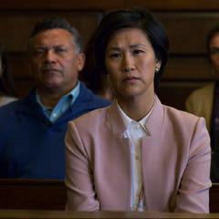 Mrs. Dempsey watching her son testify