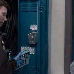 Deputy Standall searching through Clay's locker