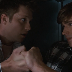 Charlie holding Alex's hand as he's having a panic attack