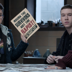 Casey holding up the poster for the funeral protest