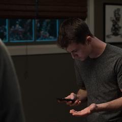 Clay looking at his phone