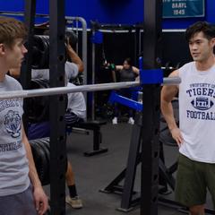 Zach helping Alex work out
