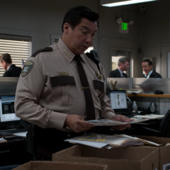 Sheriff Diaz looking at Bryce's murder evidence