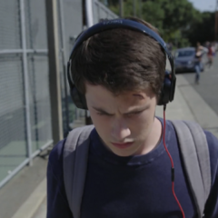 Clay listening to the tapes while walking to school