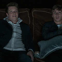 Charlie and Alex watching a movie