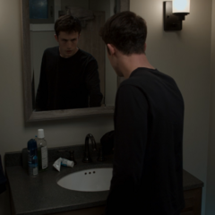 Clay looking into the mirror