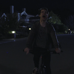 Clay screaming while riding his bike