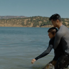 Zach pulling Alex out of the water