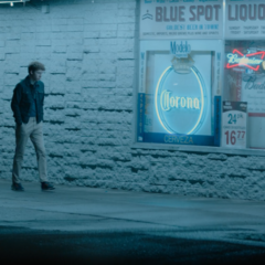 Tyler walking outside Blue Spot Liquer