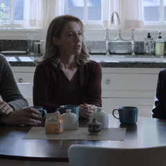 Mr. and Mrs. Jensen with Dennis at the kitchen table